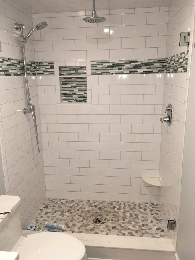 Walk in shower white ceramic tile